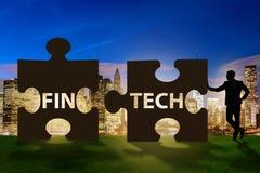Det finansiella teknologibegreppet för fintech med pusselstycken Arkivfoto