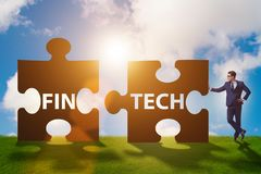 Det finansiella teknologibegreppet för fintech med pusselstycken Royaltyfri Foto