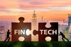Det finansiella teknologibegreppet för fintech med pusselstycken Royaltyfri Fotografi