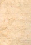 det fodrade paper arket befläckte Arkivbild