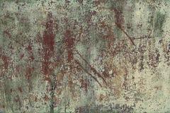 Det gamla arket som är skadat vid korrosion av stål med fläckar av exfoliating, bleknad grön målarfärg din bakgrundsdesign Arkivfoto