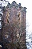 Det gamla kyrkliga tornet Royaltyfria Bilder