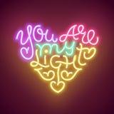 Det glödande hjärta formade uttrycket för neon är du mitt ljus också vektor för coreldrawillustration Royaltyfria Foton