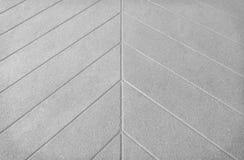 Det gråa konkreta golvet i linje skrivev ut modelltextur på bakgrund royaltyfri bild