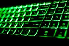 det gröna fluorescerande datortangentbordet Fotografering för Bildbyråer