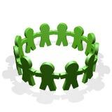 Det gröna folket förband i en cirkel som rymmer deras händer Royaltyfri Fotografi