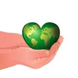 Det gröna världsinnehav i Childs räcker Royaltyfria Foton