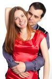 det härliga paret omfamnar den le kvinnan för den lyckliga mannen Arkivbilder
