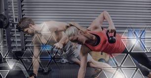 Det idrotts- passformfolket i idrottshall med triangeln har kontakt royaltyfri bild