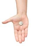 Det isolerade euromyntet gömma i handflatan handen som frågar att erbjuda Arkivbild