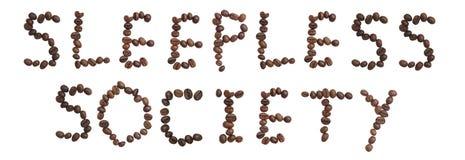 Det isolerade ordet 'SÖMNLÖST SAMHÄLLE' gör från kaffebönan Arkivbild