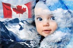 Det Kanada vinterberget behandla som ett barn Arkivbild