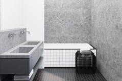 Det konkreta badrummet som beläggas med tegel badar och sjunker Arkivbild