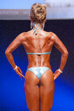 Det kvinnliga diagramet modell visar henne som är bästa på mästerskapet på etapp Arkivbilder