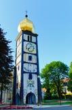 Det kyrkliga tornet med en klocka Royaltyfri Fotografi
