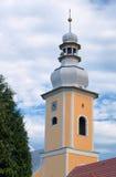 Det kyrkliga tornet med en klocka Royaltyfria Foton