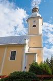Det kyrkliga tornet med en klocka Royaltyfri Bild