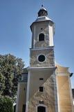 Det kyrkliga tornet med en klocka Royaltyfri Foto