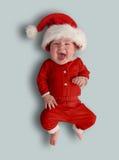 Det lilla barnet - jultomten Arkivfoto