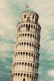 Det lutande tornet av Pisa, Tuscany, Italien Tappning som är retro arkivfoto