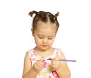 Det lyckliga barnet med en blyertspenna och en hand arkivbilder