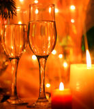 Det lyckliga nya året och glad jul utformar kortet med flöjter och stearinljuset Fotografering för Bildbyråer