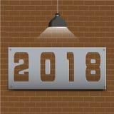 Det lyckliga nya året 2018 på brunt tegelstengolv och ljus skiner Arkivbilder