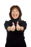 det lyftta uttryckt tumm den segerrika kvinnan Royaltyfri Foto