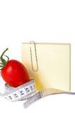 Det mätande bandet - Notepaper - sund mat och bantar royaltyfri bild