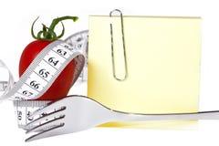 Det mätande bandet - Notepaper - sund mat och bantar arkivbilder