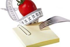 Det mätande bandet - Notepaper - sund mat och bantar arkivbild