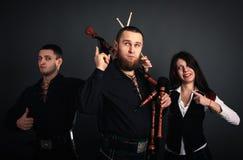 Skotskt musikaliskt musikband royaltyfria bilder