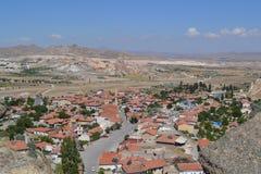 Det naturliga landskapet och husen av den Cappadocia regionen Arkivbild
