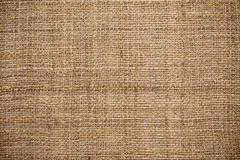 Det naturliga linnet texturerar för bakgrunden Arkivbild
