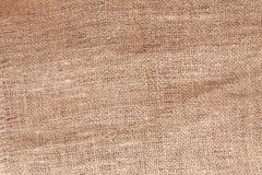 Det naturliga linnet texturerar för bakgrunden Arkivfoton