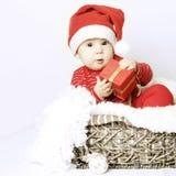 Det nya året behandla som ett barn den klädersanta hatten Arkivbild