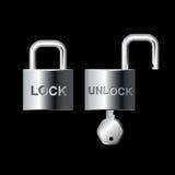 Det nyckel- låset och låser guld-silver upp Royaltyfria Foton