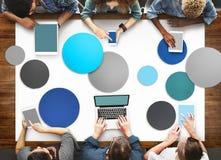 Det olika folket räcker Team Busy Devices Concept Arkivbild