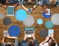 Det olika folket räcker Team Busy Devices Concept Royaltyfri Fotografi