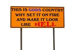 Det orange tecknet med detta är gudens land Arkivfoto