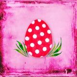 Det röda ägget med polka pricker Arkivbilder
