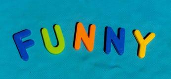 Det roliga skriftligt för ord vid leksakbokstäver Royaltyfri Bild