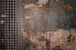 Det rostiga grungestålet för vintag som dekorerades, genom att borra en vägg, texturerade bakgrund Arkivfoto