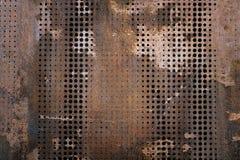 Det rostiga grungestålet för vintag som dekorerades, genom att borra en vägg, texturerade bakgrund Arkivbild