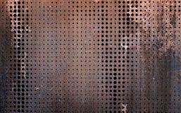 Det rostiga grungestålet för vintag som dekorerades, genom att borra en vägg, texturerade bakgrund Royaltyfria Bilder