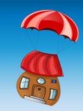 Det sagolika huset med hoppa fallskärm Royaltyfria Foton