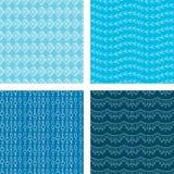 Det Seamless klottret mönstrar fastställda blått Arkivfoton