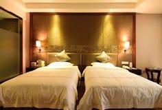 Det standarda dubbelrummet i ett hotell Fotografering för Bildbyråer