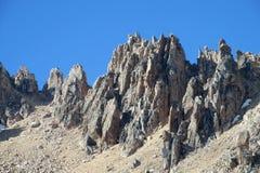 Det steniga berg nå en höjdpunkt Royaltyfri Bild
