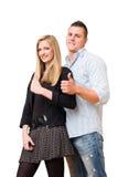 det stora paret som visar deltagaren, tumm upp barn Arkivbild
